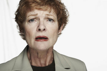 Distraught woman in suit jacket