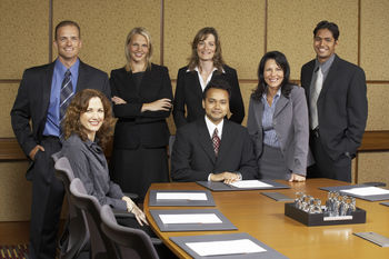 Team of business professionals in conference room