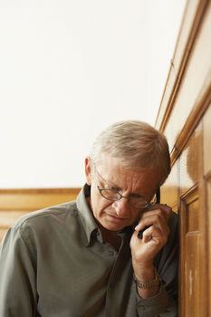 Senior professional man using cell phone