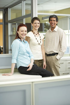 Smiling coworkers in office