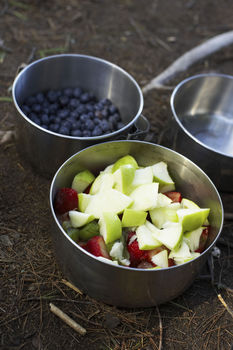 Fruit and berries in containers