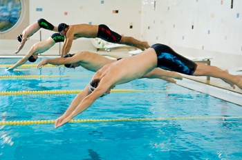 Men swimmers competing in race