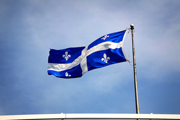 Quebec flag blowing in wind, Quebec, Canada