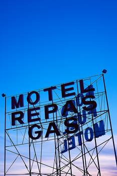 Wide angle view of sign for motel and gas