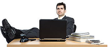 Businessman with feet propped on desk