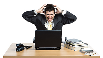 Frustrated businessman with hands in hair