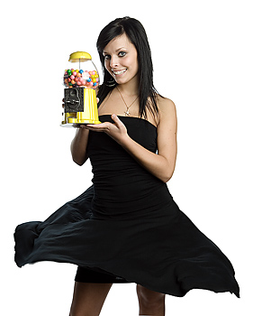 Young woman posing with gum dispenser