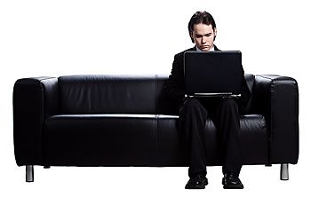 Businessman on couch with laptop computer