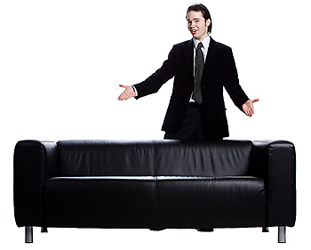 Businessman standing by couch
