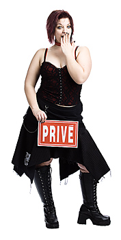 Gothic woman posing with prive sign