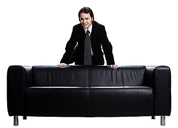 Businessman leaning over couch