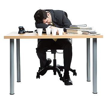 Exhausted businessman sleeping at desk
