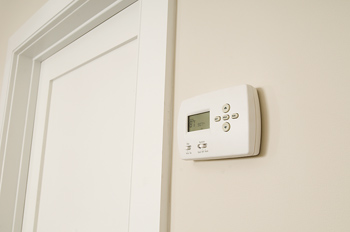 Electronic thermostat on wall