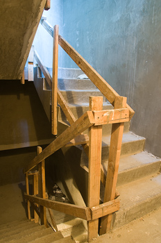 Stairs with a wooden banister