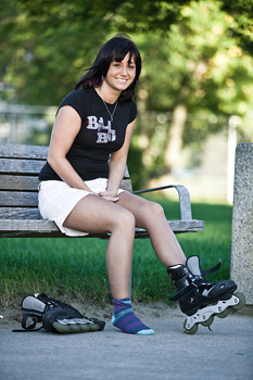 Woman on park bench with inline skates