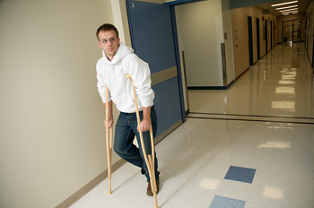 Man in hospital on crutches