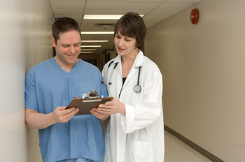 Doctors looking at a clipboard in a hospital