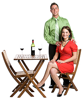 Couple smiling at table with wine