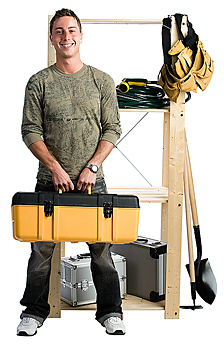 Man standing by organized tools on shelves