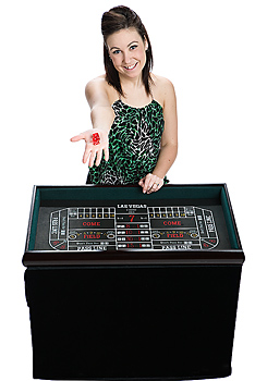 Woman holding dice at craps table
