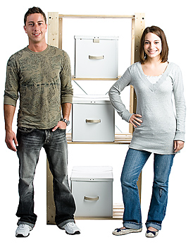 Couple standing by organized shelves