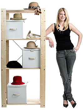 Woman standing by organized shelves