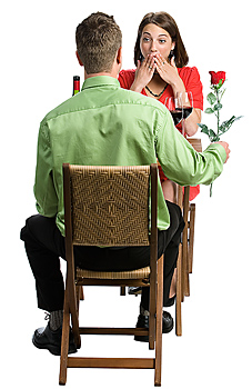 Man giving rose to surprised woman