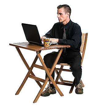 Businessman sitting at table with laptop