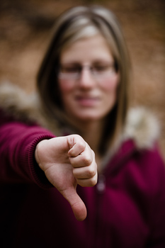 Woman giving thumbs down