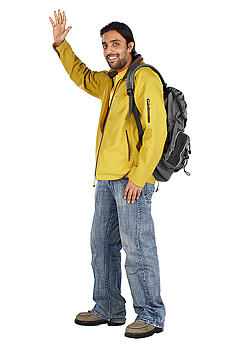 Man with backpack waving