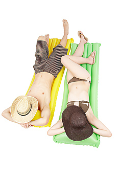 Couple lying down in bathing suits