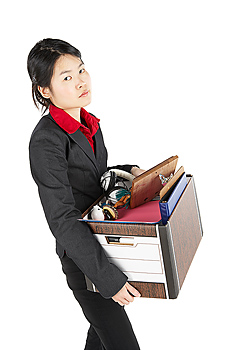Businesswoman with box of belongings