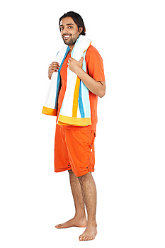 Smiling man with beach towel