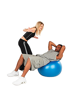 Couple working out with exercise ball