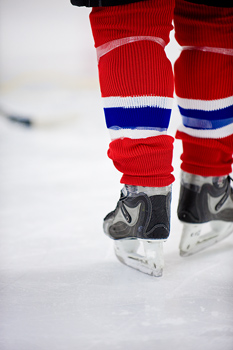 Legs of hockey player in skates