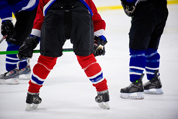 Back view of hockey players on ice