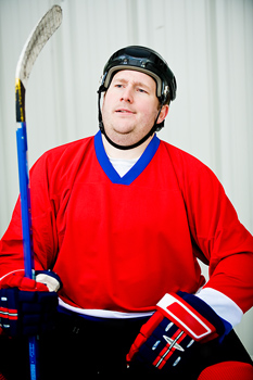 Hockey player sitting in penalty box