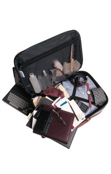 Suitcase with business travel items