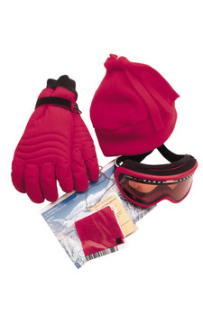 Ski lift tickets, knit hat, gloves, and goggles