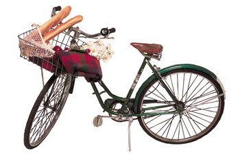 Bicycle with baguettes, blanket, and flowers