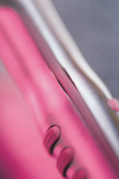 Close-up of pink metal object