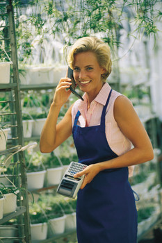 Florist with calculator and cell phone