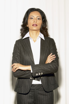 Businesswoman Posing in Suit with Arms Crossed