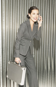 Business Woman with Cell Phone and Briefcase
