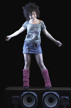 Young Woman Standing on Speakers