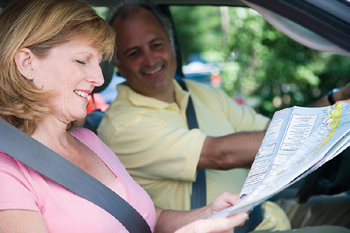 Woman passenger reading map in car