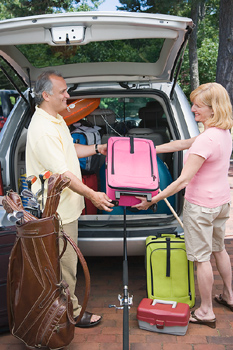 Couple loading van for vacation