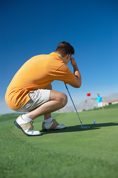 Side view of man concentrating during golf game