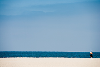 Distant view of person on beach, Venice, California