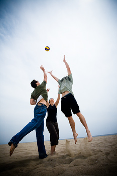 People playing volleyball at beach